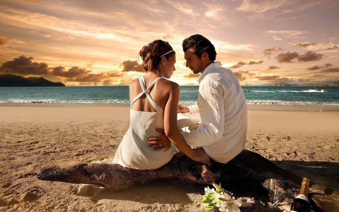 beautiful-beach-sunet-and-love-couple-700x438